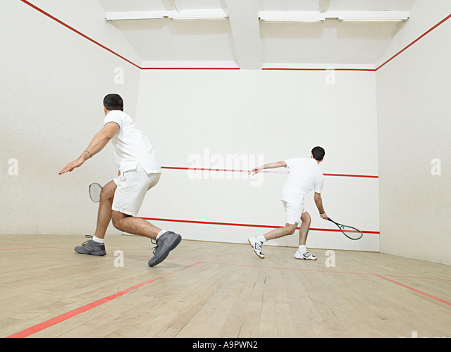 Men playing squash - Stock Image
