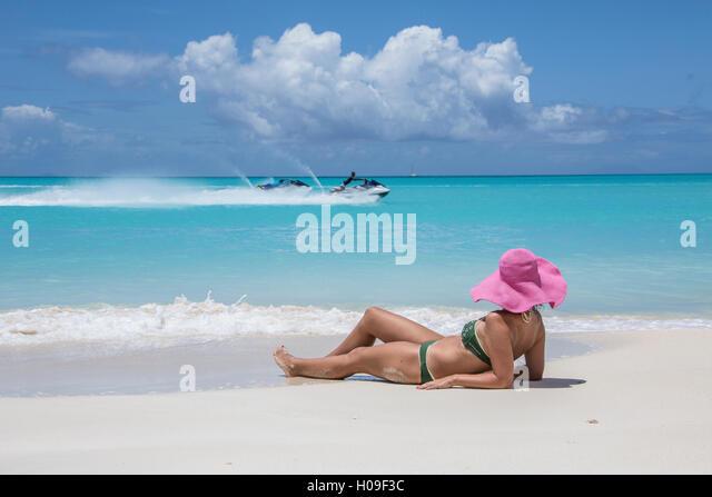 Tourist admires the turquoise Caribbean Sea, Jolly Beach, Antigua, Antigua and Barbuda, Leeward Islands, West Indies, - Stock Image