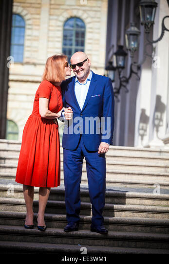 Senior women kissing man's cheek, Munich, Bavaria, Germany - Stock-Bilder