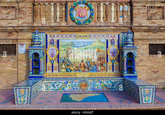 Glazed tiles bench of spanish province of Alicante at Plaza de Espana, Seville, Spain - Stock Image