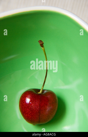 Cherry in green bowl - Stock Image