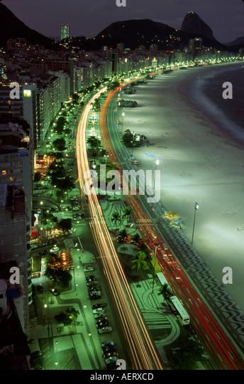 Brazil Rio de Janeiro Copacabana Beach Avenida Atlantica dawn Sugarloaf mountain - Stock Image
