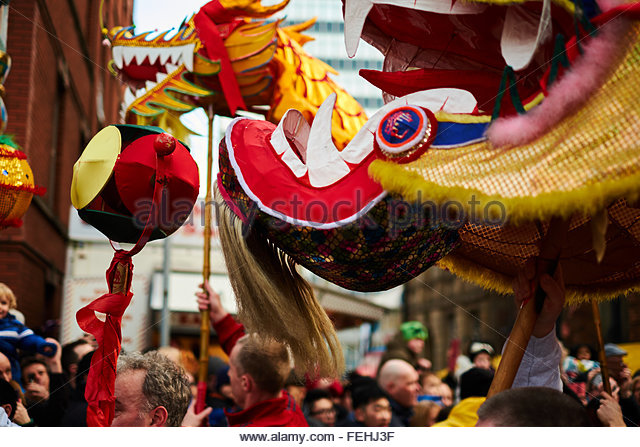 Chinese New Year celebrations in Manchester. Dragons heads at the front of the parade. - Stock Image