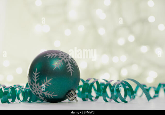 Christmas bauble and streamer decorations with fairy lights - Stock Image