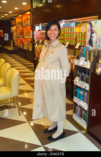 Hong Kong China Kowloon Sham Shui Po hair salon beauty parlor hairstylist Asian woman business manager owner pregnant - Stock Image