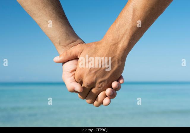 Two men holding hands, cropped - Stock-Bilder