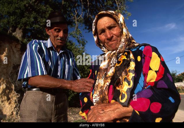 Portugal Algarve Messies do Bioxa senior gypsy couple colorful clothing - Stock Image