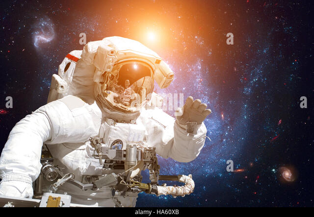 Astronaut in outer space. - Stock Image