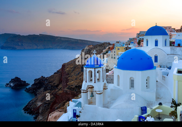 Dusk over blue domed churches at Oia Santorini Greece - Stock Image