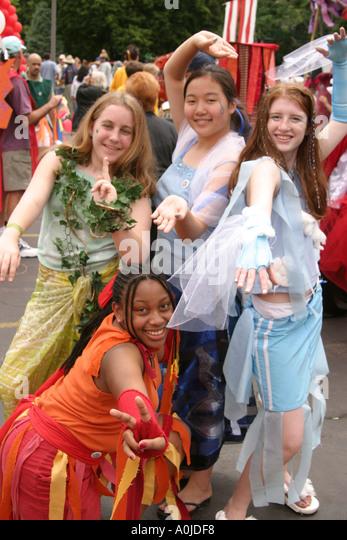 Cleveland Ohio University Circle Parade the Circle costumes masks Black Asian teens - Stock Image
