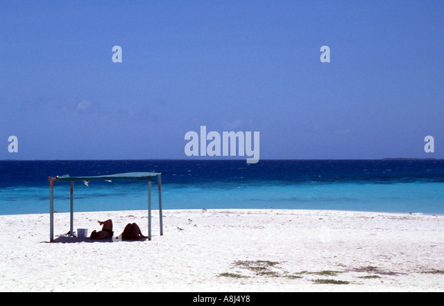 Los Roques Archipelago National Francisquí Cay couple on beach - Stock Image