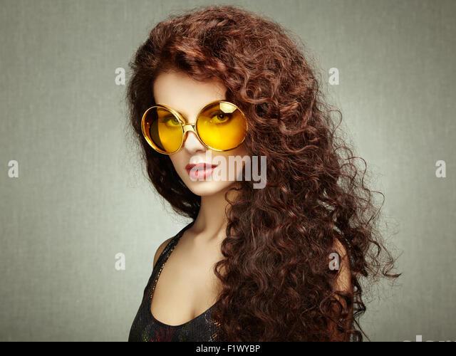 Portrait of beautiful woman in sunglasses on white background. Fashion photo - Stock Image