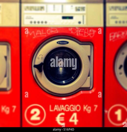 red industrial washing machine, laundrette - Stock-Bilder