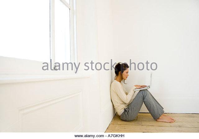 A young woman using a laptop - Stock-Bilder