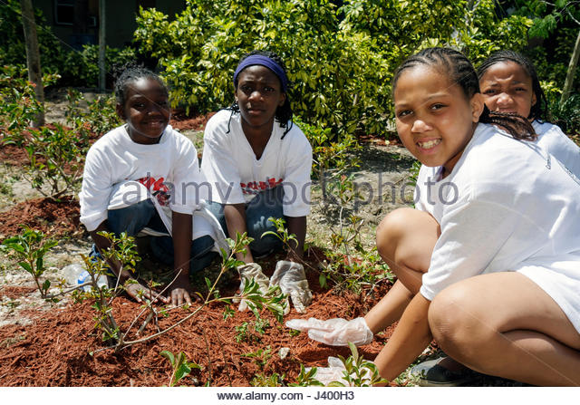 Miami Florida Overtown Peace Park Global Youth Service Day tree planting community service volunteer student Black - Stock Image