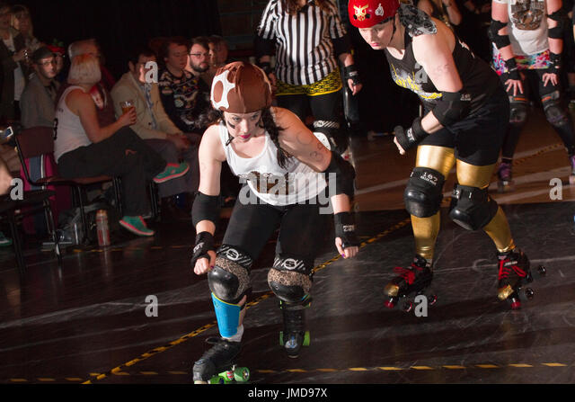 Women roller skaters competing in a roller derby bout - Stock Image