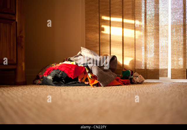 Pile of clothes on floor - Stock Image