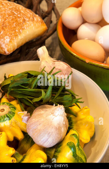 baskets of eggs, bread, squash, garlic and herb, Industrial Eats, Buellton, California - Stock Image