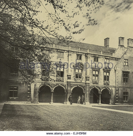 Circa 1870 Albumen print of Cambridge University open courtyard three men standing in Victorian Clothing wearing - Stock Image