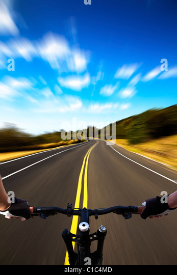 Bicycle rider with high speed view on the road - Stock Image
