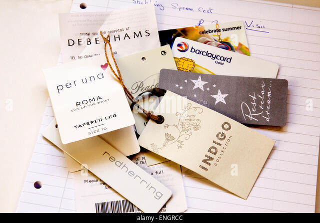 Price tags of spending spree with a note pad for adding up the cost. - Stock Image