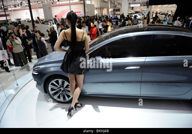 A model poses by a 5 by Peugeot concept car at the Beijing Auto Show. 24-Apr-2010 - Stock Image