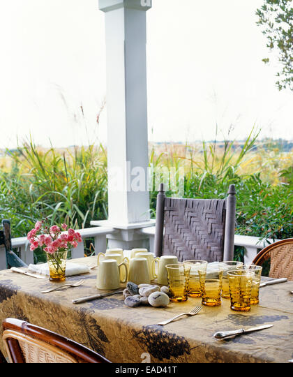setting a table on out door porch - Stock Image