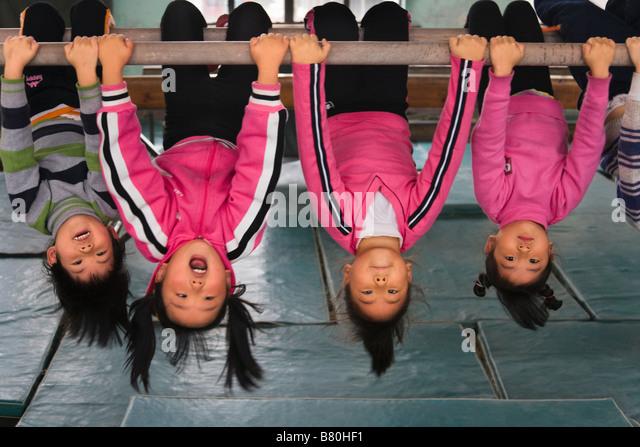 Children receiving gymnastics training China - Stock Image