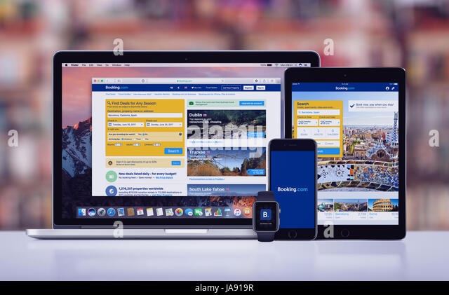 Booking.com on the Apple iPhone 7 iPad Pro Apple Watch and Macbook Pro - Stock Image