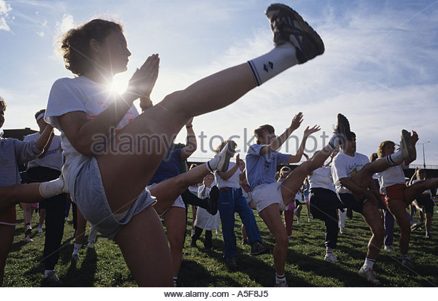 A group of people doing an exercise - Stock Image