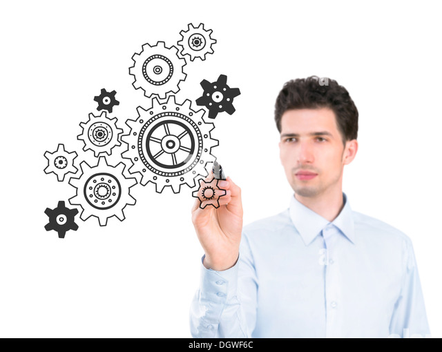 Portrait of a young pensive businessman holding a marker and drawing a concept of business development process - Stock Image