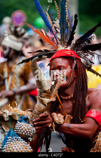 Karneval der Kulturen, ,Berlin,Festival,people,crowd,african,street,parade,color red feather,indianer,indias,apache - Stock-Bilder
