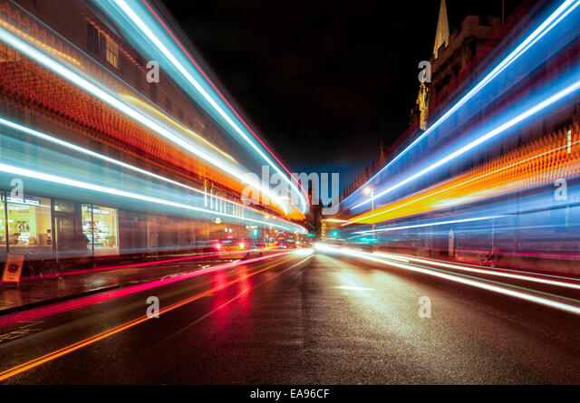 Oxford high street at night with streaks of light from passing vehicles - Stock Image