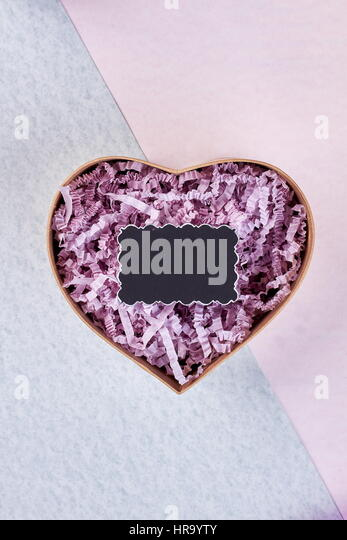 Heart-shaped box and message. - Stock Image