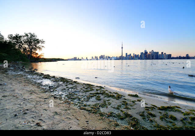 Toronto skyline in the day over lake with urban architecture. - Stock Image