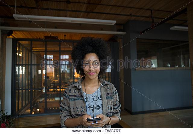 Portrait confident woman texting - Stock Image