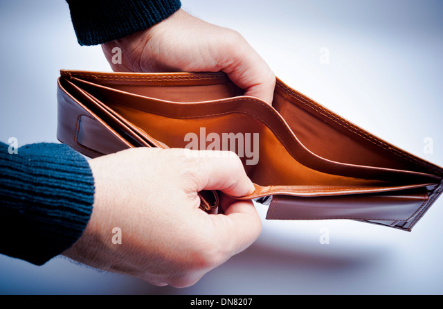 man showing an empty wallet - Stock Image