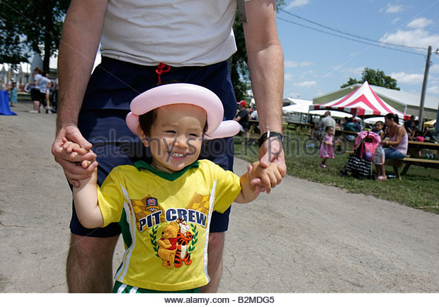 Wisconsin Kenosha Kenosha County Fairgrounds The Ultimate Kid Fest family event Asian boy parent childhood fun - Stock Image