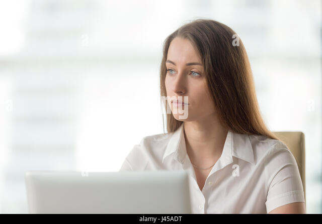 Pensive businesswoman thinking about solution - Stock Image