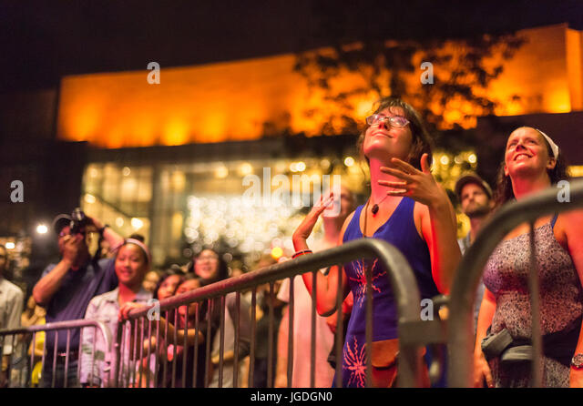 Montreal, 4 July 2017: Young woman in ecstasy at the end of  'Ghost Town Blues Band' performance at Montreal - Stock Image