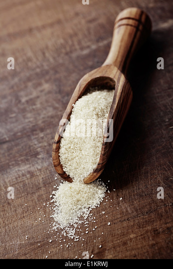 old wooden shovel with brown sugar - Stock Image