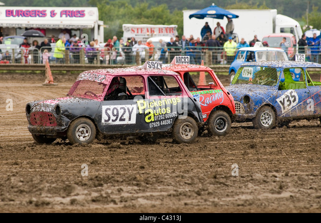 old minis at a grass track motoring racing event - Stock Image