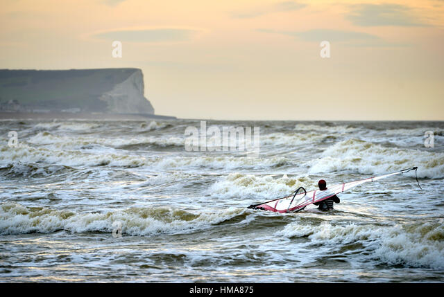 Seaford bay, East Sussex. 2nd February 2017. Kite surfers taking advantage of windy conditions on the south coast - Stock Image