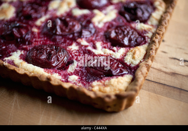 Detail of a cherry tart - Stock Image