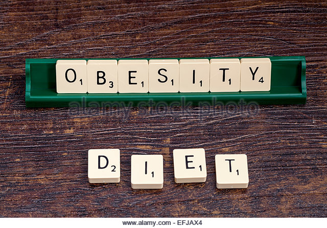 Obesity and Diet spelled out with scrabble letters - Stock Image
