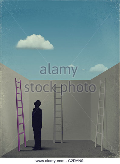 Man in box looking at ladders - Stock Image