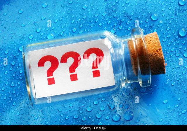 Question mark message in a bottle - Stock Image