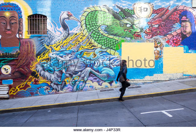 An untitled mural by artist Francisco Aquino in on Commercial Street in Chinatown in San Francisco, California, - Stock Image