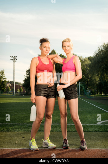 Runner standing together in park - Stock Image