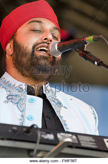 Ron Singh, vocalist and keyboard player of Kissmet performing at the Wychwood Festival, UK, 30 May 2009. - Stock Image
